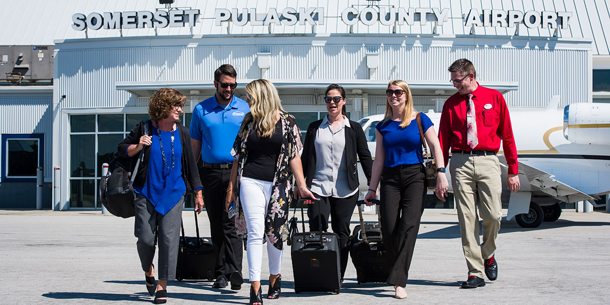 employees arriving at Somerset-Pulaski County Airport, Kentucky