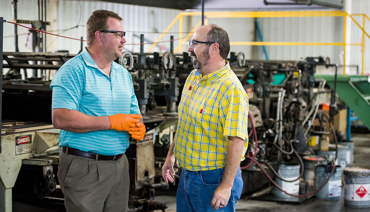 Two employees in discussion at Somerset Hardwood Flooring in Somerset-Pulaski County, Kentucky