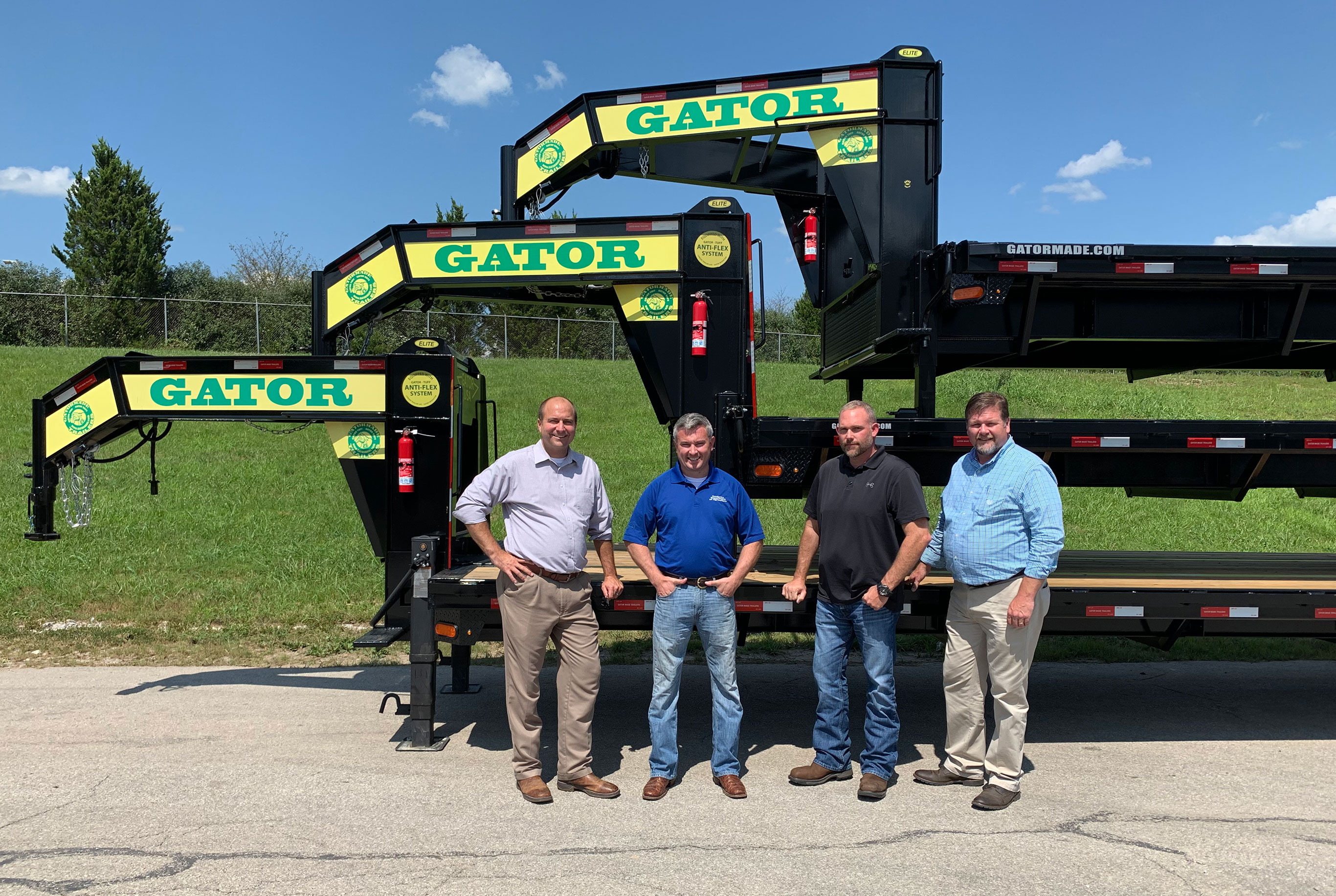 Kentucky Agriculture Commissioner Ryan Quarles at Gatormade Trailers July 26 with Chris Girdler and Judge Steve Kelley