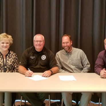 Officials sign an agreement to bring soft skills training to inmates at Pulaski County Detention Center