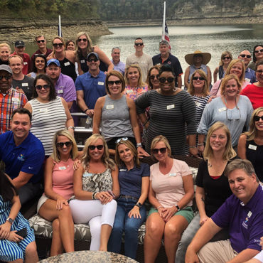 Large group of people pose for photo on houseboat on Lake Cumberland
