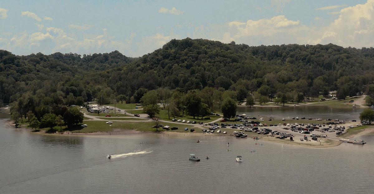 Boats leaving lake shore