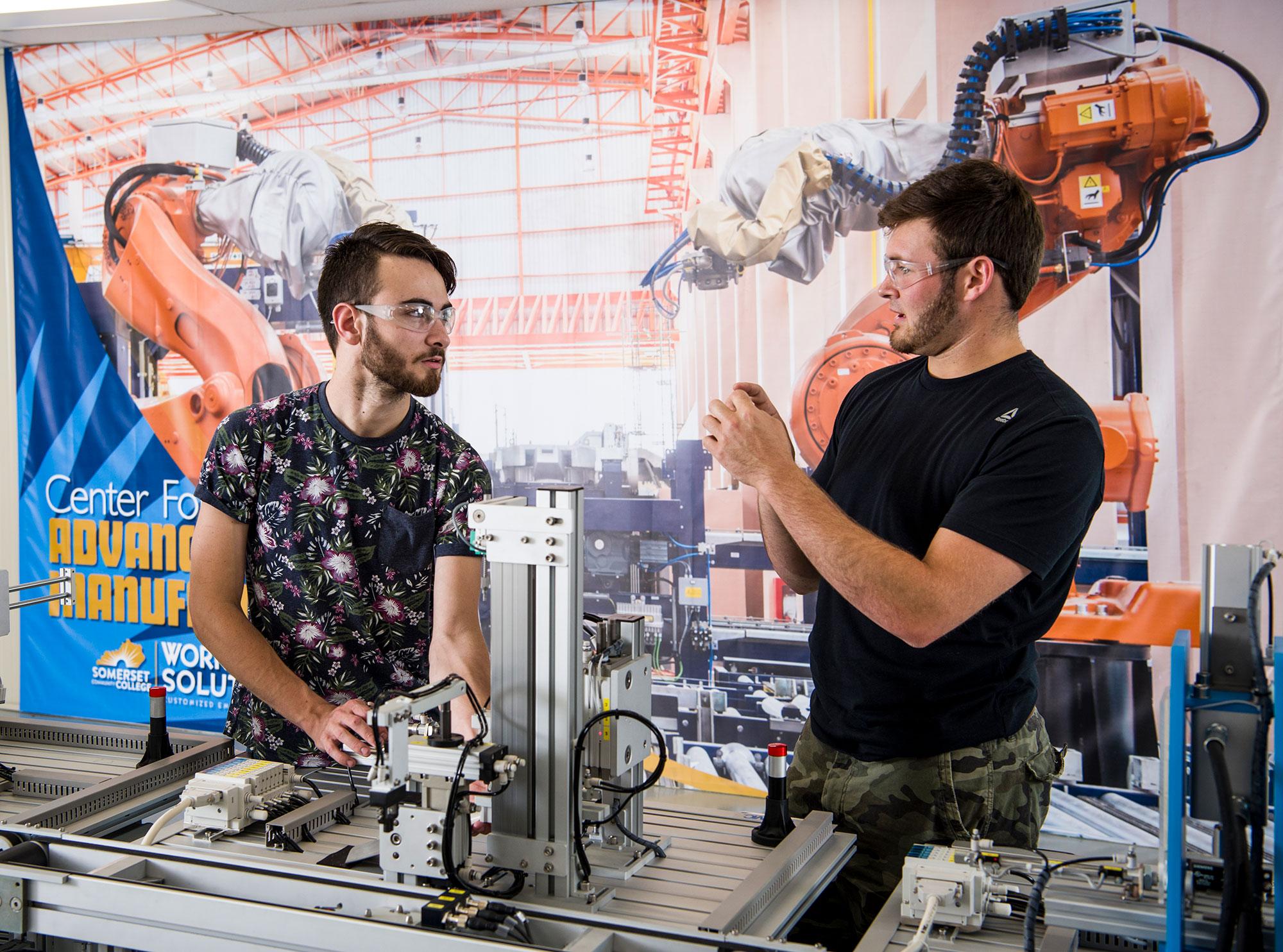 two men talking in robotics lab