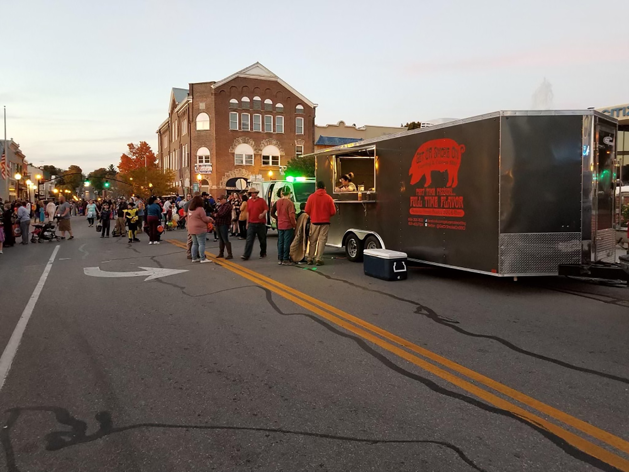 people standing in line at food truck