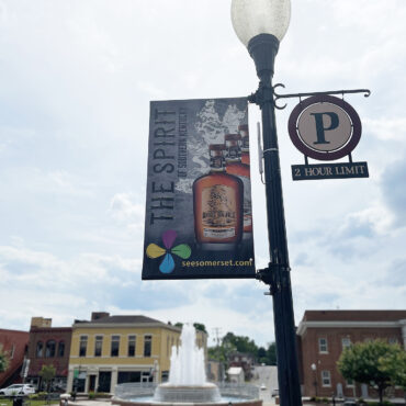 banner on light pole that reads The Spirit of Southern Kentucky with a photo of a Horse Soldier Bourbon bottle