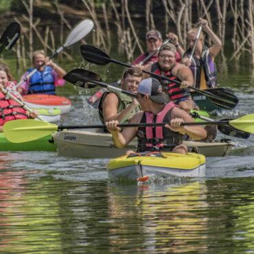 group of men and women kayaking